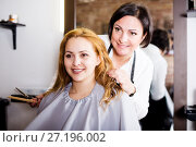 Купить «Woman consults with master in hairdress», фото № 27196002, снято 7 марта 2017 г. (c) Яков Филимонов / Фотобанк Лори