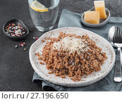 Купить «Buckwheat risotto with dried mushrooms», фото № 27196650, снято 11 ноября 2017 г. (c) Ольга Сергеева / Фотобанк Лори
