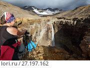Купить «Девушки фотографируют водопад в горах», фото № 27197162, снято 8 сентября 2015 г. (c) А. А. Пирагис / Фотобанк Лори