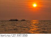 Купить «Sunset at Tonle Sap Lake», фото № 27197550, снято 17 февраля 2013 г. (c) Юлия Бабкина / Фотобанк Лори