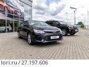 Купить «Toyota Camry in front of the motor show», фото № 27197606, снято 7 июня 2017 г. (c) Евгений Ткачёв / Фотобанк Лори