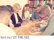 Купить «Happy students studying in classroom», фото № 27198182, снято 5 октября 2017 г. (c) Яков Филимонов / Фотобанк Лори