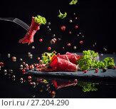 Купить «meat sliced with greens on a black background», фото № 27204290, снято 12 ноября 2017 г. (c) Майя Крученкова / Фотобанк Лори