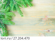 Купить «Winter background. Green fir tree branches on the wooden background. Winter still life with free space for text», фото № 27204470, снято 8 мая 2017 г. (c) Зезелина Марина / Фотобанк Лори