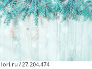 Купить «Winter background. Blue fir tree branches with winter snowflakes on the wooden background», фото № 27204474, снято 8 мая 2017 г. (c) Зезелина Марина / Фотобанк Лори