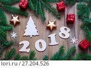 Купить «Happy New Year 2018 background with 2018 figures, Christmas toys, blue fir tree branches. New Year 2018 still life», фото № 27204526, снято 29 ноября 2016 г. (c) Зезелина Марина / Фотобанк Лори