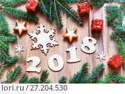 Купить «Happy New Year 2018 background with 2018 figures, Christmas toys, green fir tree branches. New Year 2018 still life», фото № 27204530, снято 29 ноября 2016 г. (c) Зезелина Марина / Фотобанк Лори