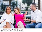 Купить «Girlfriends are rejecting stranger man who wants acquintance with them», фото № 27204662, снято 18 октября 2017 г. (c) Яков Филимонов / Фотобанк Лори