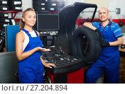 Купить «Two technicians working in car service», фото № 27204894, снято 19 сентября 2019 г. (c) Яков Филимонов / Фотобанк Лори