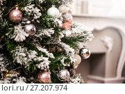 Купить «decorations on a Christmas tree and glare of lights», фото № 27207974, снято 4 ноября 2017 г. (c) katalinks / Фотобанк Лори