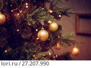 Купить «decorations on a Christmas tree and glare of lights», фото № 27207990, снято 4 ноября 2017 г. (c) katalinks / Фотобанк Лори