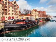Купить «Quay of the Christianshavn canals in Copenhagen with boats, plea», фото № 27209270, снято 10 марта 2012 г. (c) Ольга Визави / Фотобанк Лори