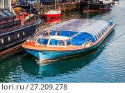 Купить «Quay of the Christianshavn canals in Copenhagen with boats, plea», фото № 27209278, снято 10 марта 2012 г. (c) Ольга Визави / Фотобанк Лори