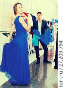 Купить «Bright emotions of a girl from buying a dress», фото № 27209794, снято 11 апреля 2017 г. (c) Яков Филимонов / Фотобанк Лори