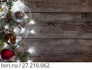 Купить «Christmas tree garland glows», фото № 27210062, снято 15 ноября 2017 г. (c) Типляшина Евгения / Фотобанк Лори