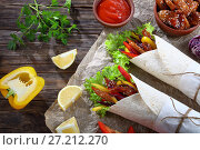 Купить «shawarma wraps with frisee lettuce, close-up», фото № 27212270, снято 5 ноября 2017 г. (c) Oksana Zh / Фотобанк Лори