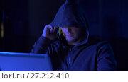 Купить «hacker with laptop calling on cellphone», видеоролик № 27212410, снято 12 ноября 2017 г. (c) Syda Productions / Фотобанк Лори