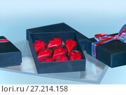 Купить «Конфеты шоколадные в форме губ в коробке. Ручная работа», фото № 27214158, снято 5 марта 2016 г. (c) Татьяна Белова / Фотобанк Лори