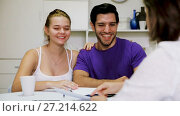 Купить «Happy young couple meeting financial adviser for investment at home», видеоролик № 27214622, снято 16 октября 2017 г. (c) Яков Филимонов / Фотобанк Лори