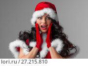 Купить «Pin-up Santa girl», фото № 27215810, снято 27 ноября 2016 г. (c) Иван Михайлов / Фотобанк Лори