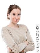 Купить «vertical portrait of a smiling European girl on a white background in isolation», фото № 27216454, снято 16 февраля 2016 г. (c) Константин Лабунский / Фотобанк Лори