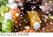 Купить «bottles with different fruit or vegetable juices», фото № 27216838, снято 5 августа 2016 г. (c) Syda Productions / Фотобанк Лори