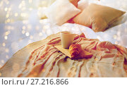 Купить «coffee cup and croissant on plaid in bed at home», фото № 27216866, снято 15 октября 2016 г. (c) Syda Productions / Фотобанк Лори