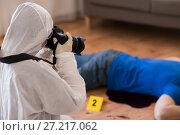 Купить «criminalist photographing dead body at crime scene», фото № 27217062, снято 5 мая 2017 г. (c) Syda Productions / Фотобанк Лори