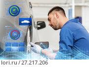Купить «mechanic with screwdriver changing car tire», фото № 27217206, снято 1 июля 2016 г. (c) Syda Productions / Фотобанк Лори