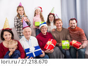 Купить «Family members making family photo», фото № 27218670, снято 25 мая 2018 г. (c) Яков Филимонов / Фотобанк Лори