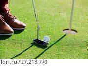 Golf player using golf club. Стоковое фото, фотограф Яков Филимонов / Фотобанк Лори