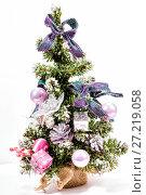 Купить «Christmas tree with pink balls on a white background», фото № 27219058, снято 20 декабря 2015 г. (c) Евгений Ткачёв / Фотобанк Лори