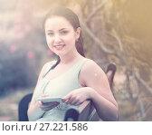 Купить «spring positive cheerful young female portrait in garden», фото № 27221586, снято 18 апреля 2017 г. (c) Яков Филимонов / Фотобанк Лори