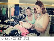 Купить «Young women friends selecting new basics pants», фото № 27221762, снято 19 июня 2017 г. (c) Яков Филимонов / Фотобанк Лори
