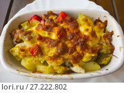 Купить «Zapekanka, traditional Bulgarian oven baked cheese topped casserole dish, with seafood, Varna, Bulgaria.», фото № 27222802, снято 28 июня 2017 г. (c) age Fotostock / Фотобанк Лори