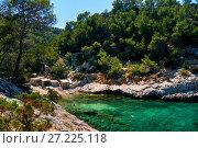 Купить «Coastline surrounded by stone formations in Puerto de San Miguel of Ibiza. Spain», фото № 27225118, снято 12 июня 2017 г. (c) Alexander Tihonovs / Фотобанк Лори
