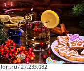 Купить «Christmas gluhwein glass mug and Christmas multicolored cookies.», фото № 27233082, снято 26 ноября 2016 г. (c) Gennadiy Poznyakov / Фотобанк Лори