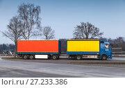 Купить «Commercial truck with a trailer stands on street», фото № 27233386, снято 10 февраля 2017 г. (c) EugeneSergeev / Фотобанк Лори