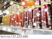 Купить «close up of beer or cider cans at liquor store», фото № 27233686, снято 2 ноября 2016 г. (c) Syda Productions / Фотобанк Лори