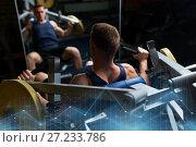 Купить «man doing chest press on exercise machine in gym», фото № 27233786, снято 2 июля 2017 г. (c) Syda Productions / Фотобанк Лори