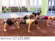 Купить «group of people doing push-ups in gym», фото № 27233886, снято 19 февраля 2017 г. (c) Syda Productions / Фотобанк Лори