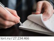 Купить «Мужчина подписывает пачку документов», эксклюзивное фото № 27234466, снято 6 ноября 2017 г. (c) Игорь Низов / Фотобанк Лори