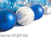 Купить «Christmas decorations of blue and silver color on white background - balls and tinsel», фото № 27237122, снято 24 ноября 2017 г. (c) Юлия Бабкина / Фотобанк Лори
