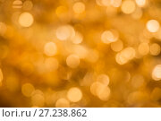 Купить «Abstract bokeh background golden color», фото № 27238862, снято 26 ноября 2017 г. (c) Юлия Бабкина / Фотобанк Лори