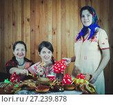 Купить «Women eats pancake with tea during Shrovetide», фото № 27239878, снято 6 марта 2011 г. (c) Яков Филимонов / Фотобанк Лори