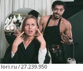 Купить «professional makeup artist with female shocked», фото № 27239950, снято 14 декабря 2017 г. (c) Яков Филимонов / Фотобанк Лори