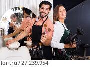 Купить «woman hairdresser and man makeup artist», фото № 27239954, снято 23 сентября 2018 г. (c) Яков Филимонов / Фотобанк Лори