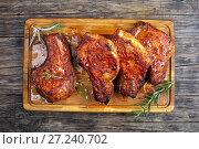 Купить «juicy Pork Chops on a wooden board», фото № 27240702, снято 13 ноября 2017 г. (c) Oksana Zh / Фотобанк Лори