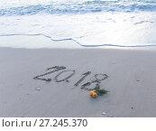 Купить «Figures 2018 on the sand», фото № 27245370, снято 20 ноября 2017 г. (c) Ekaterina Andreeva / Фотобанк Лори