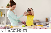 Купить «mother and daughter having fun at home kitchen», видеоролик № 27245478, снято 21 ноября 2017 г. (c) Syda Productions / Фотобанк Лори
